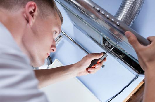 Technician performing an equipment installation