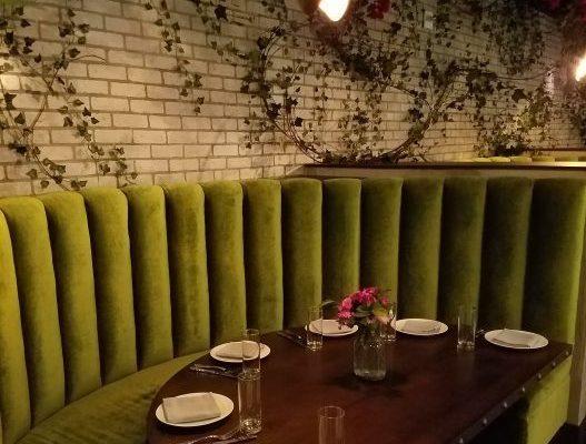 Green cushion seating at La Vie