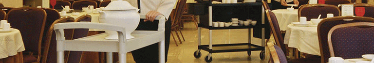 cart and tea kettles being pushed by a waitress