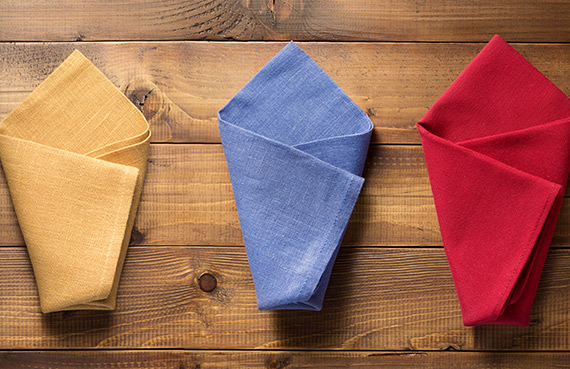 Colorful folded napkins on a wooden table