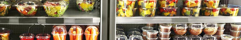 display of refrigerated food from salad to pudding