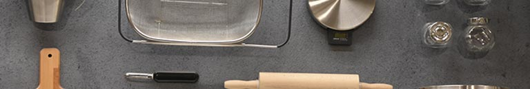 Kitchenware and baking utensils arranged on a gray counter